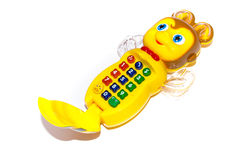 Musical baby toy phone on a white background. The toy runs on batteries Stock Photography
