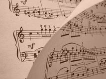 Musical background. Sepia toned old musical notes background Mozart sonatina fragment Royalty Free Stock Images