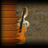 Musical background blurred brick wall and wood planks guitar Royalty Free Stock Photos