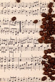 Musical background with coffee beans Royalty Free Stock Images