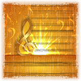 Musical background with a gold treble clef Royalty Free Stock Image