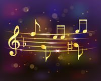 Musical background with golden notes. Abstract shiny musical background. Royalty Free Stock Image
