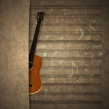 Musical background guitar on old sheet music notation Stock Image