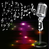 Musical background with a microphone and music notes. Royalty Free Stock Photography