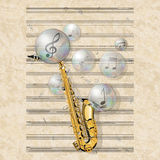 Musical background with saxophone and soap bubbles Royalty Free Stock Photo