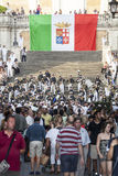 Musical band and Italian Flag in the Spanish Steps in Rome, Italy. Crowd people Stock Images