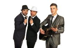 Musical band of men royalty free stock photos