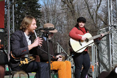 Musical band performs in stage. MOSCOW - MARCH 18, 2017: Musical band performs in stage. Saint Patrick`s Day celebration in Moscow. Sokolniki park. Color photo Royalty Free Stock Photography