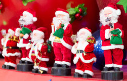 Musical band of Santa Claus. Musical band comprising of Father christmas figures. Each playing a different instruments Stock Photography