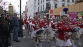 Musical bands parade through the streets of Oslo. Norway stock video footage