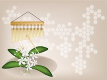 A Musical Bar Chimes and Jasmine on Brown Backgrou Royalty Free Stock Photos