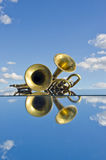 Musical brass wind instruments on mirror Royalty Free Stock Photos