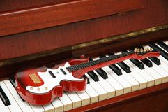 Musical concept - Rock guitar. On  the piano keys Stock Images