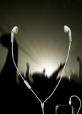 Musical concert with headphones. Musical concert with white headphones Royalty Free Stock Image