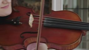 Musical craft by exultant female violinist at camera. 4K stock video