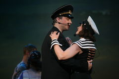 Musical dance number with a nautical theme performed by the actors of the troupe of the St. Petersburg music hall. Stock Photos