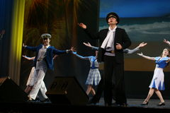 Musical dance number with a nautical theme performed by the actors of the troupe of the St. Petersburg music hall. Stock Photo