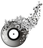 Musical disk with butterflies Stock Photos