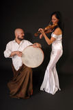 Musical duet drum and violin Stock Photography