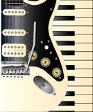 Musical Duo. A solid body electric guitar and a set of piano or synthesiser keys Royalty Free Stock Images