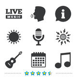 Musical elements icon. Microphone and guitar. Stock Photo