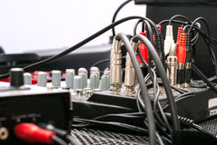 Musical equipment - close up of cables and buttons - black, red, silver Royalty Free Stock Photos