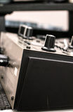 Musical equipment - close up of the edge of amplifier with buttons Royalty Free Stock Images