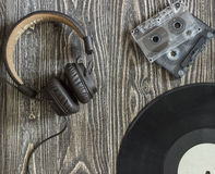 The musical equipment headphones audio cassette and  plate Royalty Free Stock Photo