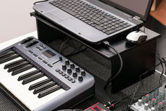 Musical equipment - laptop and a synthesizer Stock Images