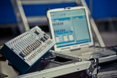 Musical equipment and monitor sound engineer Stock Image