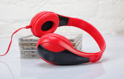 Musical equipment - Red headphone and CD Royalty Free Stock Images
