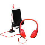 Musical equipment - Red headphone and smartphone. Isolated Royalty Free Stock Photo