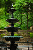 Musical falling water - cast iron fountain. Gently falling water trickles and splashes from one level to the next. The sound is a gentle music Royalty Free Stock Photos
