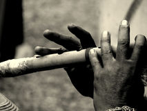 Musical fingers. An old man playing the flute Stock Image