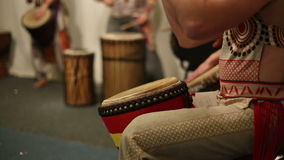 Musical group plays ethnic drums djembe stock footage