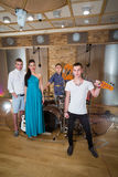 Musical group of three guys and one girl in Recording Studio Stock Photography