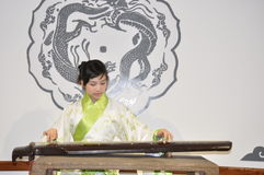 Musical instrument. A Chinese girl in traditional costume playing Guzheng Royalty Free Stock Photography