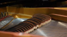 Musical instrument abstract: piano and piano strings. Playing the piano when the lid is opened, the strings rise and royalty free stock photo
