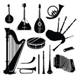 Musical instrument  collection. Ethnic and classic music instruments  set. Musical instrument silhouette on white background Royalty Free Stock Photography
