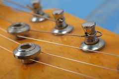 Musical instrument - Fragment headstock neck tuning peg electric  guitar. Musical instrument - Fragment headstock peghead neck tuning peg electric guitar on a stock photos