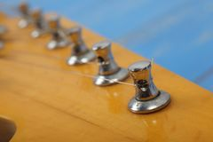 Musical instrument - Fragment headstock neck tuning peg electric guitar. Musical instrument - Fragment headstock peghead neck tuning peg electric guitar on a stock photo