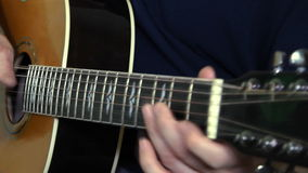 Musical instrument with guitarist hands stock footage