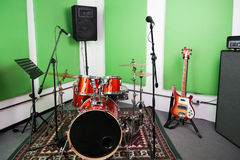 Musical Instrument And Microphones In Studio. Musical instrument and microphones in recording studio royalty free stock photography