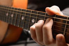 Musical instrument with performer hands Stock Image
