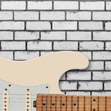 Musical instrument - Silhouette electric guitar brick wall. Musical instrument - Silhouette electric guitar on a white brick wall background royalty free stock image