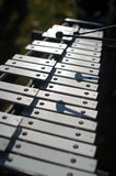 Musical instrument. A musical instrument in which the sound is produced by striking metal bars of varying pitches Royalty Free Stock Photography