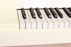 Musical instrument. White piano close-up. Piano keys royalty free stock photo