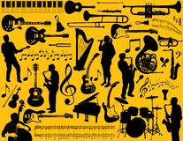Musical instruments. Illustration of various musical instruments and elements.  Against a yellow background.  Vector format available Royalty Free Stock Photos