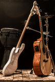 musical instruments, acoustic guitar and bass guitar and percussion instruments drums stock photos