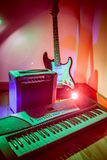 Musical instruments. Amplifier guitar and keyboard royalty free stock photo